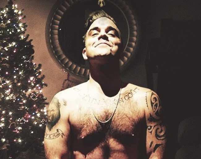 Robbie Williams nudo a Natale i baci che vorrebbe ricevere