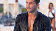 Alessio Bruno di Temptation Island bagnato in piscina con i vestiti addosso